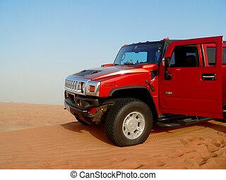 Strong four wheels car in desert