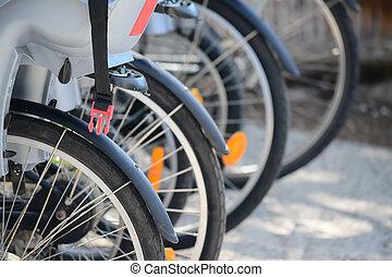 bike wheel - detail of a bike wheel in a rental agency