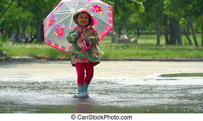 Dancing in the Rain - Girl having the time of her life in...