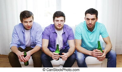 happy male friends with beer watching tv at home -...
