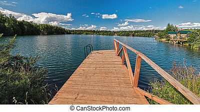 Lake amidst beautiful clouds. - Lake in the Moscow region in...