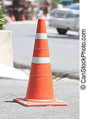 traffic cones. - Traffic cones placed on the road.