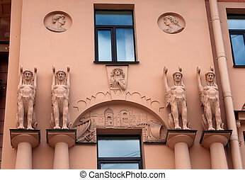 Facade old house with sculptures in the Egyptian style -...