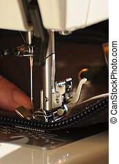 Sewing 002 - A detail view of a sewing machine