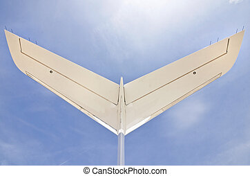 Tail of a Jet Aiplane with a blue sky - Tail of a modern...