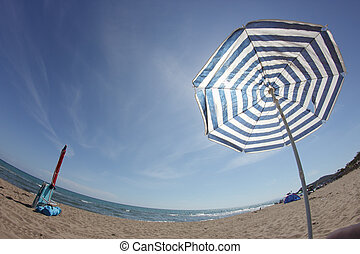 parasol beach - beach umbrella in a fish-eye view