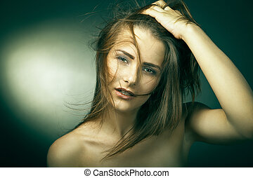 Young woman with beautiful long brown hairs