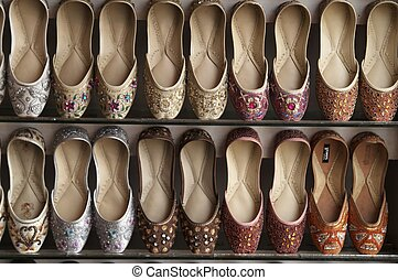 Camel Skin Shoes - Rack of traditional Indian shoes made of...