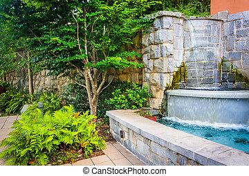 Fountain and garden at Piedmont Park in Atlanta, Georgia. -...