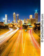 Traffic on Freedom Parkway and the Atlanta skyline at night,...