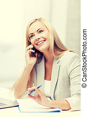 businesswoman with phone - businesswoman talking on the...
