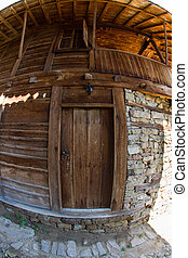 Wooden door in the rural architectu - Mountain eco-village...