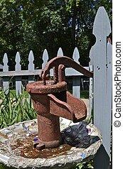 Cistern water pump in bird bath - An old rusty cistern hand...