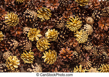 Pinecones - Background of real brown and gold pine cones