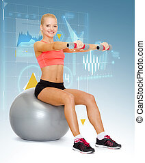 woman with dumbbells sitting on fitness ball - fitness,...