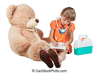Baby is playing doctor, treats a bear, isolated on white...