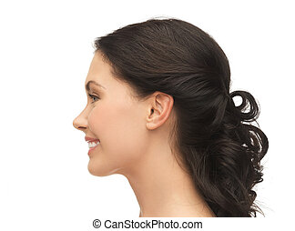 profile portrait of smiling young woman - beauty and health...