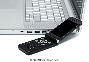 Mobile phone and laptop - Mobile phone on the keyboard of a...