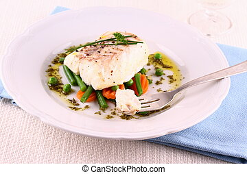 Cod fillet on fork with green beans, peas, parsley, olive...