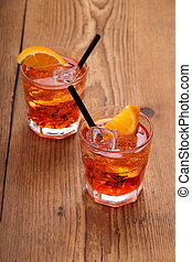Spritz aperitif, two orange cocktail with ice cubes, top...