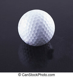 Golf ball - White golf ball over a black background