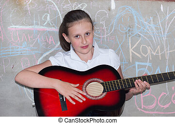 10-12 years girl playing a guitar - girl 10-12 years with a...