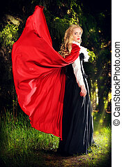 role-playing - Beautiful blonde woman in old-fashioned dress...