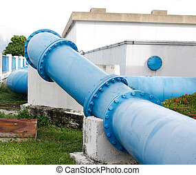 big blue Steel pipes and couplings of an irrigation water