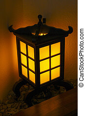 Decorative lantern in a Japanese style in a corner near the...