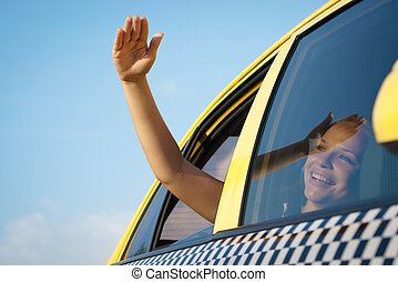 woman in taxi waving hand out of car window - people...