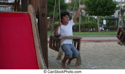 Happy boy swinging - Happy young boy on swing