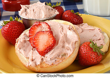 Bagels with strawberry cream cheese - Toasted bagels with...