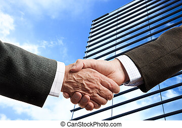 business handshake - special toned photo f/x, focus point on...