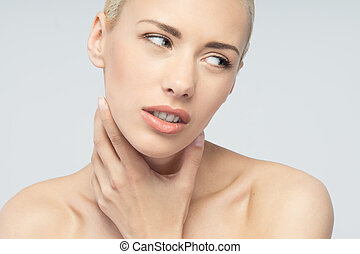 Pain concept Young woman with touching her throat and head -...
