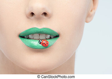Closeup portrait of beautiful woman with green lipstick and...