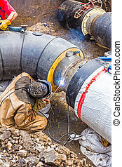 Metalworker working on a pipeline