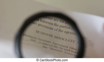 Reading a contract under magnifying glass
