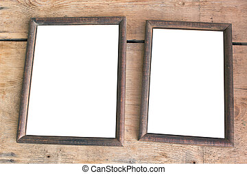 Two old photo frames on wooden background