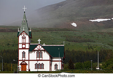 Husavik church at Husavik harbor, Iceland