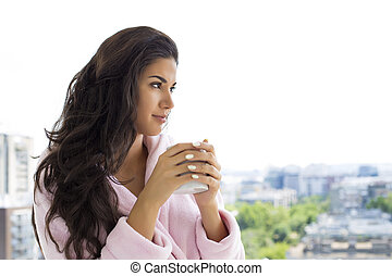 Morning coffee - Young woman having a morning coffee on...