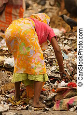 Rubbish Sorting In Calcutta - Indian lady in brightly...