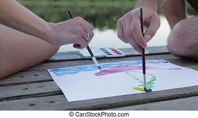 draw a toy-ship - two hands draw ashore a toy-ship on a...