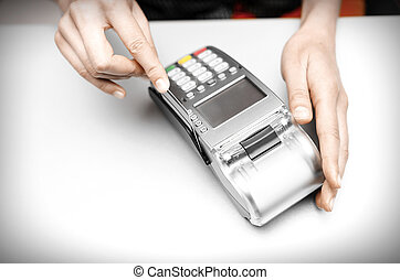Bank terminal - Female hand holding bank terminal and...