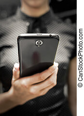 Smartphone - Woman holding a big black smartphone in hand