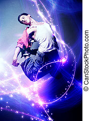 Young man dancer With lights traces and sparks