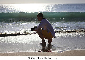 Photographer on a beach - The photographer with the camera...