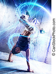 Break dance - Young man break danceing on wall background.
