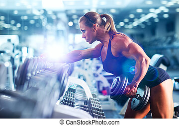 Woman bodybuilder - Young woman bodybuilder with dumbbell
