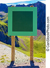 Board with textspace on mountains background