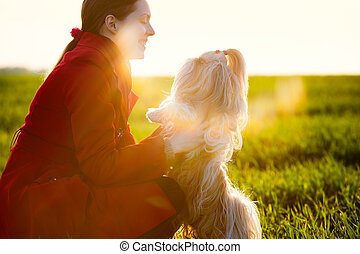 Woman with dog - Young woman with favorite dog at sunset...